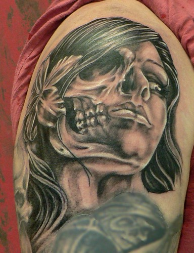 Skull face Girl, done by Mr. Red Dog Tattoo in Benalmádena.
