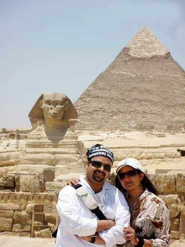 Kavya Madhavan and Nischal Chandran with Egyptian pyramid as background during their honeymoon