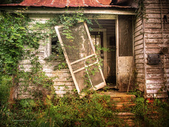 Unhinged (evanleavitt) Tags: county door wood roof house texture abandoned home overgrown rural ga georgia tin darkness decay empty south country rusty olympus american gordon weathered lonely homestead hdr wilkinson the unhinged e510 photomatix