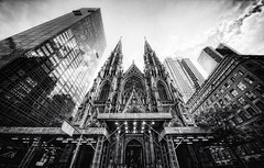 St. Patrick's Cathedral (Philipp Klinger Photography) Tags: new york city nyc travel windows light shadow sky bw usa white ny black tree church window saint st architecture clouds facade america reflections us blackwhite nikon catholic angle cathedral pov manhattan united gothic von wide perspective center sw states patricks rockefeller avenue amerika 5th philipp sigma1224mm fifth staaten klinger vereinigte of d700 dcdead vanagram
