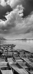 Polish Shore (Ben Heine) Tags: old blackandwhite bw lake reflection water weather clouds composition river boats vent photography countryside oldstyle wind noiretblanc nikond70 horizon perspective peaceful poland polska manipulation rivire shore nuages bateau temps tones forecast rhythm oldfashioned wisa vistula meteo fleuve waterscape highres strongcontrast smallboat grays pologne chaloupe compositeimage paisible otwock wiatr vistule benheine brasdemer vosplusbellesphotos hubzay flickrunitedaward