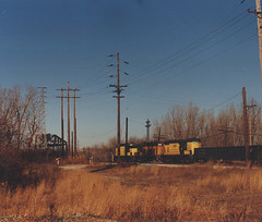 Northbound Chicago & NorthWestern Railroad transfer train passing through Argo Junction. Summit Illinois. December 1990.