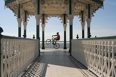 Ade Stunt (yvoluna) Tags: travel tourism bike seaside brighton transport entertainment cycle exhibitionist exhibitionism entertainer bandstand performer ade velo excentric biycle excentricity countadrianofettucini