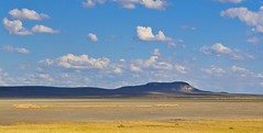 Flat Great Basin Desert (kmanohar) Tags: desert nevada swirl blueskies i80 puffyclouds greatbasin interstate80 rockformation whirl nevadadesert communicationstower naturalformation westerndesert missilesilo dryland aridregion northernnevada greatbasindesert drydesert churchillcounty strangeformation northernnevadadesert strangemarking nevadamountain scenicnevada nevadabasin churchillcountynevada churchillnevada nevadagreatbasin dryamerica dryusa dryregion strangenaturalformation aridusa aridnevada colorfulnevada beautifulnevada spectacularnevada