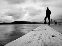 Lack of focus (dubbelt_halvslag) Tags: wood bridge light sky people blackandwhite bw cloud white mountain man black blur water weather norway rock stone canon evening coast stavanger norge marine raw angle marin perspective himmel calm fjord scandinavia vatten fjell rogaland moln lackoffocus g10