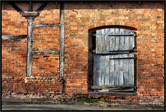 Brick and Timber. (Pat Dalton...) Tags: door shadow building sunshine geotagged leicestershire pavement timber farm bricks ashbymagna canon450d sigma1770lens pdeee454 patdalton geo:lat=52509254 geo:lon=117177