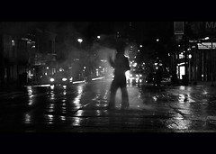 in the heat of night. (Vitaliy P.) Tags: street new york city nyc bw woman white black wet girl rain silhouette lady night umbrella project four 50mm lucy high nikon manhattan cab smoke grain young taxis steam east iso midtown rainy crop late year2 gothamist 365 noise cinematic raining 34 thirty cabbies month8 project365 d80 vitaliyp thischarmingbroad