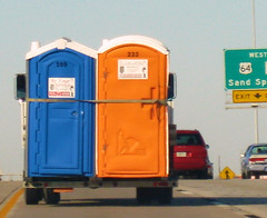 The Flying Porta-Potties (dart5150) Tags: road blue orange airport highway funny story tulsa portapotties flyingdowntheroad funniestthingiveseeninawhile
