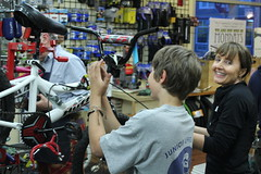 Volunteers working on Holiday Bike Drive bicycles