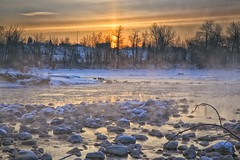 Harvie Passage sunrise (John Andersen (JPAndersen images)) Tags: bowriver calgary cold frozen geese march skyline steam sunpillar towers