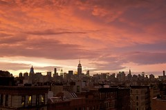 Manhattan Sunset (oliver_selwyn (view LARGE on black!)) Tags: new york city nyc light sunset sky storm rooftop skyline clouds amazing colorful village manhattan vivid east midtown ev alphabet hue 2009 tenement mammatus june26 challengeyou challengeyouwinner lpsky