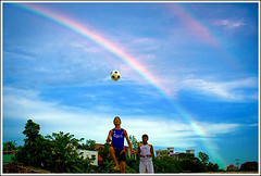 Rainbow time [..Dhaka, Bangladesh..] (Catch the dream) Tags: sky people cloud game colors beauty rain season football rainbow colorful play spectrum bongo joy dramatic player bow gradient leisure dhaka bangladesh enthusiasm rainyseason bangladeshi sudden gettyimagesbangladeshq2