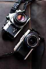 Olympus e-p1 and om-1 side by side (hhdoan) Tags: leather pen olympus om om1 leatherette ep1 cameraporn digitalpen leatherskin akiasahi
