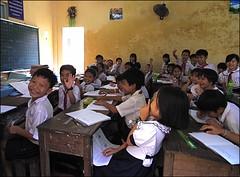 Chut !... (Christian Lagat) Tags: school boy girl jaune classroom vietnam laugh duras tableau grdigital fille blackboard mekong ecole classe rire ocre garçon uniforme chut sadec primaire margueriteduras ricohgrd ecolier