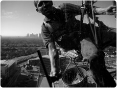 Window Washer 110609 (14bwf) (nffcnnr) Tags: blackandwhite building window danger skyscraper dallas office texas tx officebuilding wash highrise dfw windowwasher kera dangle squeegee consumerist dangerousjob nffcnnr pegnews premierplace