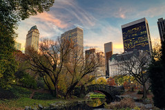 Sunset over Gapstow Bridge, Central Park, NYC, looking southeast (andrew c mace) Tags: park plaza new york city nyc newyorkcity bridge sunset building skyline pond cityscape centralpark central fifthavenue centralparksouth bloombergtower gapstow sonybuilding solowbuilding generalmotorsbuilding sherrynetherland nikoncapturenx