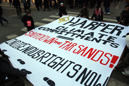 Protesters block street with massive tar sands banner