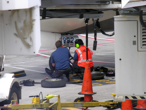 Changing the plane's tire