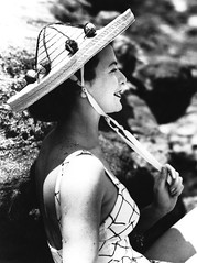 Hat being modelled for a T. C. Beirne advertisement, Brisbane, 1951 (State Library of Queensland, Australia) Tags: woman hat outdoors profile advertisement 1950s queensland swimsuits strawhat 1951 statelibraryofqueensland bathingbeauties slq harrypoulsen