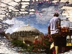 Hagia Sophia dome & floating pink flowers (peggyhr) Tags: pink friends sky orange man black water clouds turkey puddle grey gallery stripes istanbul cobblestones sidewalk transparency hagiasophia picnik flipped floweringtree cornstand flippedreflections 50faves123 globalvillage2 peggyhr 9234b creativemaster parallelworldpuddles massivedome