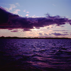 .. (Js) Tags: autumn sky sunlight toronto 6x6 clouds mediumformat square evening waves fuji purple sundown horizon blues velvia hues epson 100 backlit lakeontario yashica innerharbour mat124g ferryride rvp100 v700