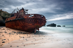 Lost in the mercy of tides (CResende) Tags: longexposure light sea seascape luz portugal rock landscape mar nikon stones tide wave ondas baa mar oldboat rochas d90 vnmilfontes sigma1020 nd110 costavincentina photowalker nikond300 hitechfilters cresende