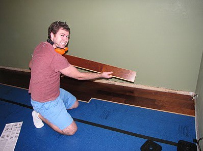 Kenny putting down a board