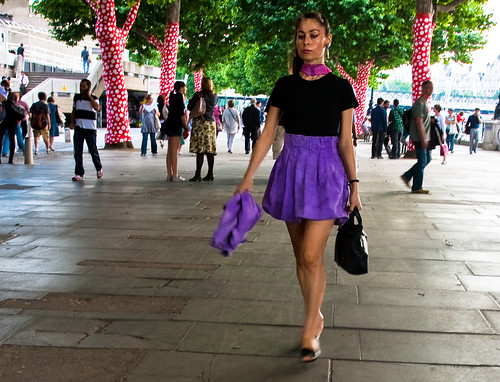 Lady in a purple skirt, and polka dot trees