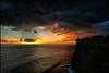Stormy Sunset Punch (Souvik_Prometure) Tags: sunset bali rain silhouette indonesia shower explore uluwatu frontpage thunder sigma1020mm uluwatutemple purauluwatu nikond80 ulluwatu souvikbhattacharya