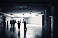 Invasion (Philipp Klinger Photography) Tags: door new york city nyc travel blue light shadow people bw usa white ny black reflection wall ferry backlight island us cool nikon floor state manhattan united elevator von terminal ceiling creepy explore empire states exit statenisland amerika frontpage philipp invasion staten toning staaten klinger vereinigte flickrshop of d700 sigma50mmf14 platinumheartaward dcdead