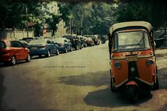 Against The Mainstream (khaniv13) Tags: street orange public analog indonesia pentax k1000 jakarta transportation vehicle rickshaw bajaj threewheeled konicaminoltavx200 helios44258mm khaniv13 onlycanbeseenin