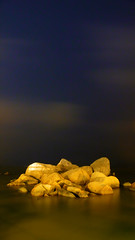 Zhuhai - Night Rocks (cnmark) Tags: china blue light sea sky seascape yellow night clouds landscape geotagged golden noche moving rocks nacht smooth scenic explore boulders guangdong granite noite  nuit notte zhuhai southchinasea lu pearlriver nachtaufnahme    otw explored allrightsreserved jiuzhou   jida platinumheartaward loversavenue qingl qinglv geo:lat=22264599 geo:lon=113584245