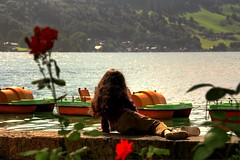 Peaceful Joy (Bo AhmaD) Tags: flowers mountain lake girl boats austria zellamsee boahmad