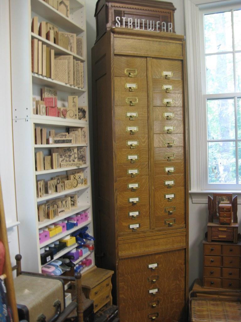 Vintage oak cabinet in studio corner:  postal label cabinet