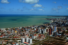 Somos a porta do sol... (Fabiana Velso) Tags: cidade verde praia branco azul cores mar orla cu joopessoa nuvens area prdios oceano paraba frenteafrente portadosol fabianavelso renataarruda