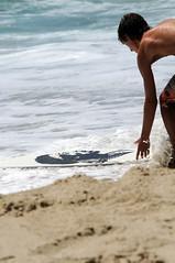 Washing Mr. Hendrix (n1ksp1cs) Tags: beach surf skimboard jimmyhendrix