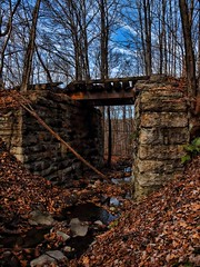 Abandoned Railway Bridge (huskypup22) Tags: railroad bridge pennsylvania stonework olympus stonewall coal carbondale breaker railbed abandonedrailway 1442 gravityrailroad photoshopcs4 e620 topazadjust