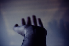 (yltsahg) Tags: light colors dark 50mm lights shadows dof hand fingers 2009