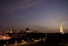 Pre Fireworks (Bruce Bordelon) Tags: sunset summer sky skyline buildings rouge lights nikon louisiana downtown traffic state capital fourthofjuly d200 f28 baton lightstreaks 1424mm