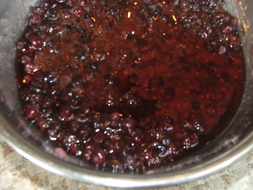 Mashed serviceberries, lemon juice, and sugar after macerating in the fridge