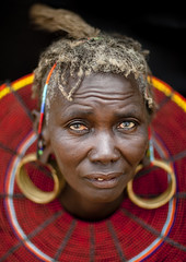 Old Pokot woman with a giant beaded necklace - Kenya (Eric Lafforgue) Tags: africa portrait people face kenya african feather culture tribal rings human ear tribes afrika remote tradition tribe ethnic tribo visage afrique ethnology tribu eastafrica pokot qunia 7463 lafforgue ethnie  qunia    kea    a