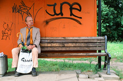 Alexei (liber) Tags: leica old orange man film bench graffiti delete2 fuji save3 tie delete3 save7 save8 delete delete4 save save2 latvia save9 velvia save4 save5 save10 save6 riga asa50 savedbythedeletemeuncensoredgroup ignorantfools