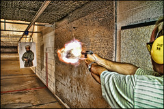 firing range - minneapolis, mn (Dan Anderson (dead camera, RIP)) Tags: minnesota gun shoot arms minneapolis indoor 45 weapon pistol target osamabinladen shooting aim practice revolver handgun bullets range mn blast binladen firing deadly glock firearm semiautomatic smithwesson billsgunshoprange
