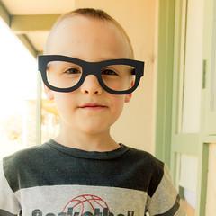 mini nerd (elyse patten) Tags: boy black nerd children kid young australia warmlight lightroom nerdglasses canon40d rebeccalilysspringhazepreset