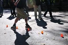 Walk N' Roll (AviDigital) Tags: nyc shadow men rollers d300 centralprk