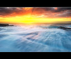 a few moments before sunrise (Pawel Papis Photography) Tags: ocean morning red sky sun white seascape beach nature water beauty yellow clouds sunrise landscape rocks sydney wave australia rush seashore clovelly hdr sigma1020 canon400d