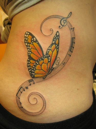 cute BUTTERFLY TATTOO combinated with musical note DESIGNS