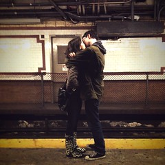 First Kiss (antonkawasaki) Tags: portraits tile couple industrial candid pipes streetphotography lovers fencing camerabag rubble soulmates yellowline iphone firstkiss boyandgirl sarawithoutanh subwaystories instantfilter antonkawasaki zakwithoutac kissingonasubwayplatform mobilephotogroup