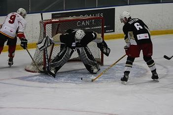 Action shot at Hockey for the hHomeless Calgary