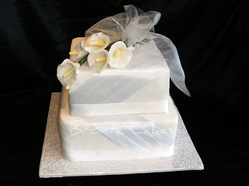 Wedding cakerich dark fruit cake iced with fondant Calla Lilies made